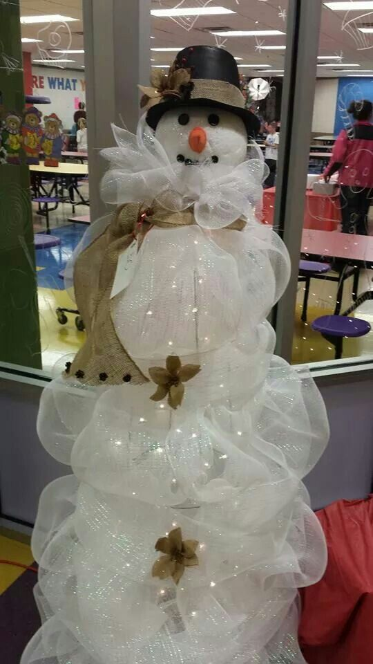 Tomato cage snowman made by PTO burlap: