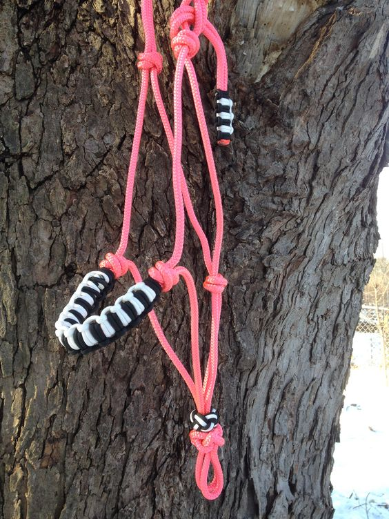 Rope horse halter in pink with paracord braided noseband and accents in black and white.  #ropehalter #horsehalter #paracord #naturalhorsemanship