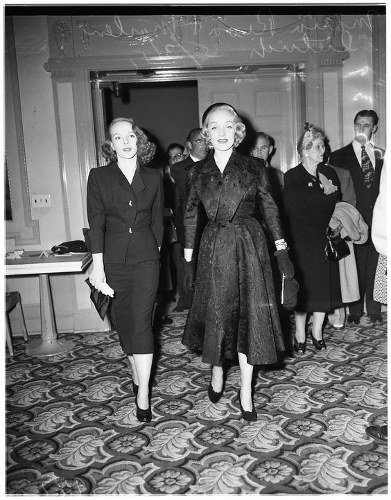Marlene Dietrich & daughter Maria Riva arrive at a party, 1951.: