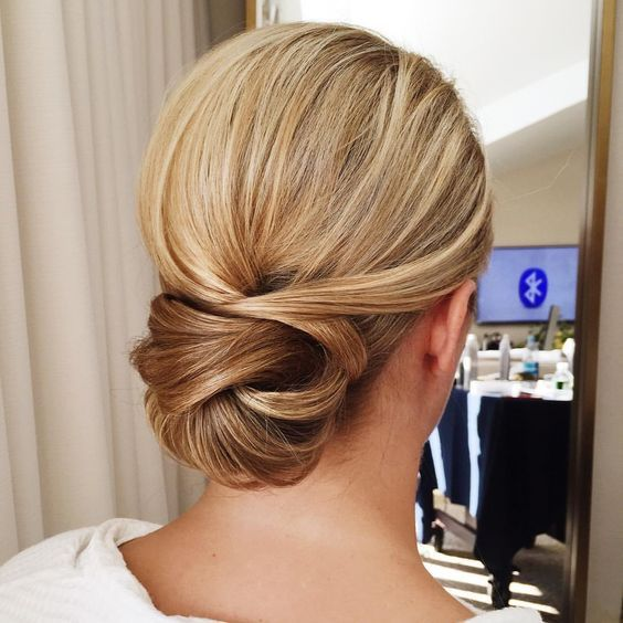 A Chic Tight Low Bun With Twists Will Last All Day Long And Will Fit Even The Most Formal Style Long Hair Styles Medium Hair Styles Low Bun Hairstyles