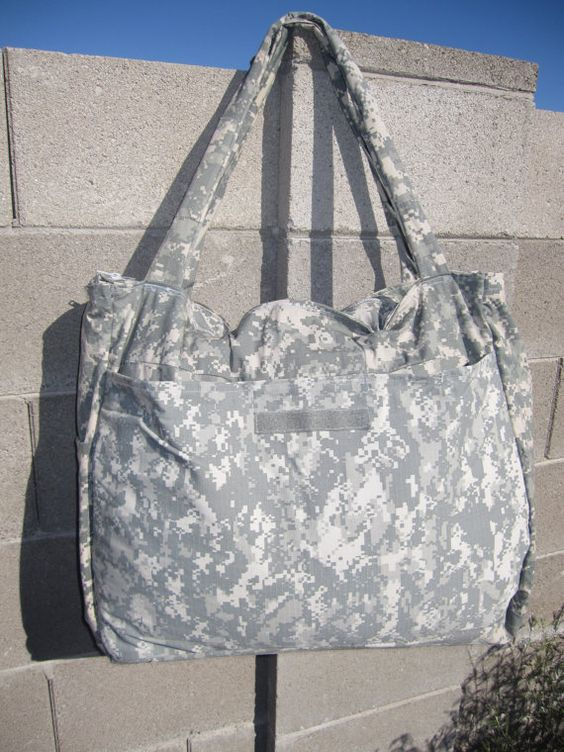 Luggage tote made from recycled military uniforms - love these