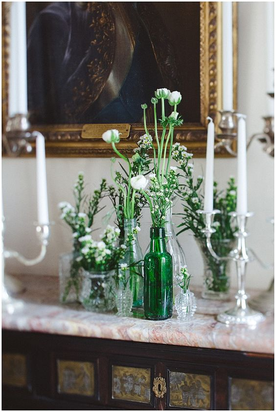 White blooms in green glass bottles. Photography by www.mckinley-rodgers.com/index2.php#!/HOME