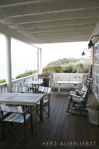 This is like my dream porch except I want a big ceiling fan and a better porch swing. Ahhh.