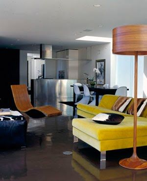 Glossy oil-spill floors, stainless-steel kitchen counter, warm wood and canary-yellow velvet.