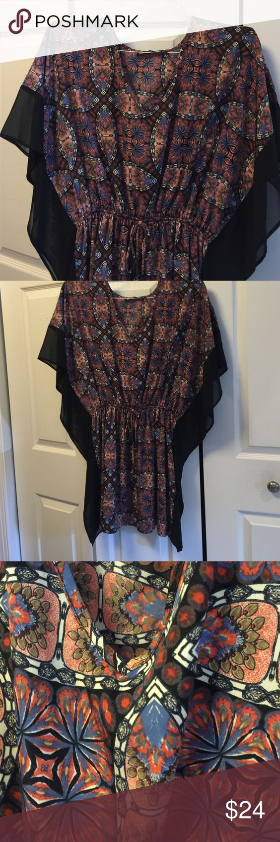 Sheer short sleeve poncho top Beautiful pattern colors waste tie is full it's elastic it stretches covers behind Shortsleeve perfect condition very attractive with black pants by together you and I Tops Tees - Short Sleeve
