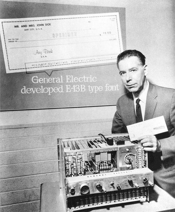 General Electric presents check with E13B font. The E13B font you still find on American checks kickstarted MICR (Magnetic Ink Character Recognition) and hence OCR (Optical Character Recognition) technology. And Kenneth Eldredge, the man in the picture, invented the first machine-readable typeface.