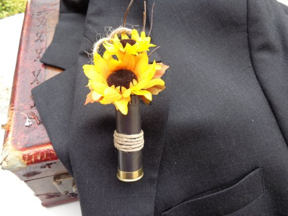 Boutonniere designed in a spent shotgun by AlwaysElegantBridal