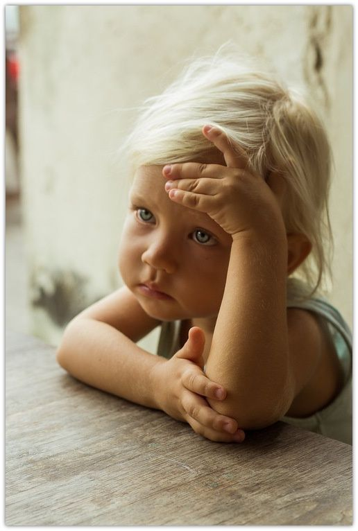 Beautiful blonde child with a worried look. #child #photography #pensive