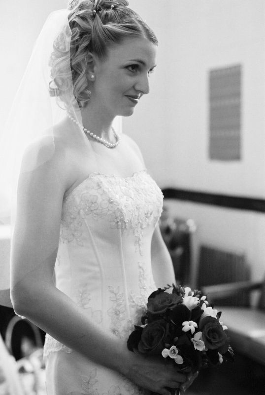 Antique lace dress, pearls, and curled and pinned hair...and a happy bride!