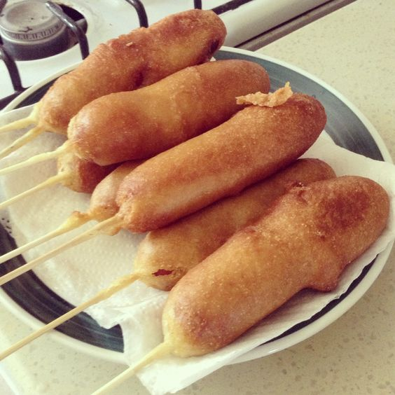 "The Corn Dog Palace - Mix 1c jiffy mix, 1c all purpose flour, 1 1/2c milk, 1/4c sugar, 1 tbsp honey, 1tbsp baking powder, 1tsp salt, 1egg beaten. Pour batter into tall glass. Skewer dogs (pat them dry) then dip them in the batter. Gently roll while dunking them in the hot oil. Cook about 2-3mins or until golden brown. Allow grease to drain onto paper towel, the  eat. Now your home can be called ""The Corn Dog Palace"" too! :o)"