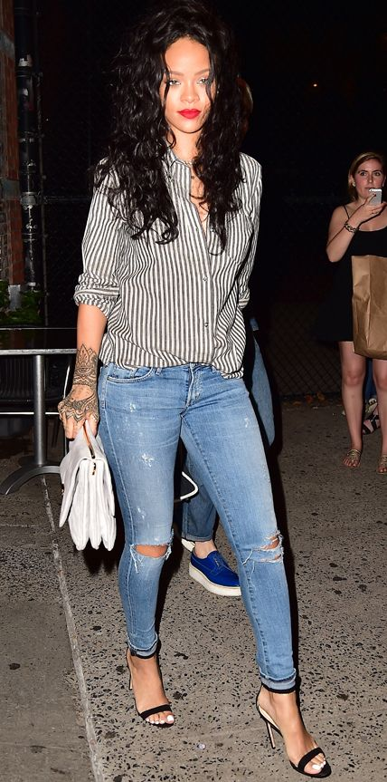 Rihanna elevated her destroyed denim skinnies with an oversize gray-and-white striped button-down, a handlebar clutch, and ankle-strap sandals. #stylish #fashion #rihanna #riri #stripes: