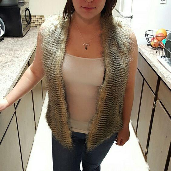 Fur Vest Faux fur vest with black knit back with pockets. Runs big. Grace Elements Jackets & Coats Vests