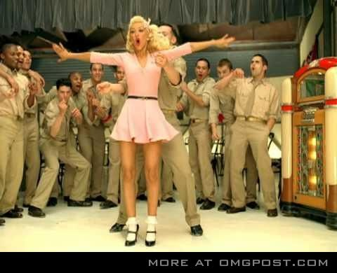 This is another still from Christina Aguilera's 'Candy Man' video. It was used for promotional purposes. Here one can see that the marines seem to be having a good time, and getting the attention of a pretty girl.