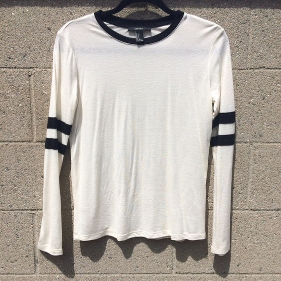 Black & Cream Sporty Ringer Top Black and cream white color. Great condition. Long sleeve. Lightweight and soft. Sporty vibe. Ringer style. Speckled. Forever 21 Tops Tees - Long Sleeve