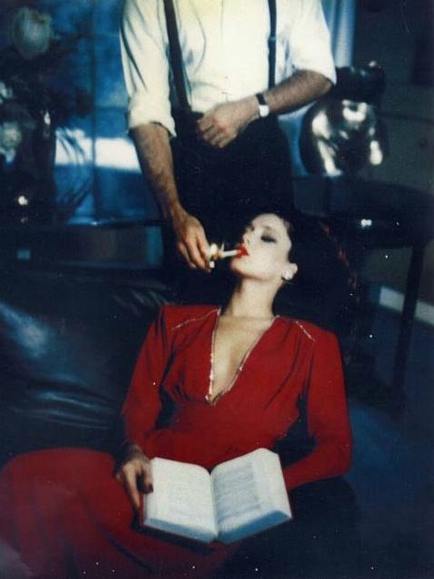 Helmut Newton, red lipstick, sigaret, men woman (aka the rarity of a beheaded male figure in a fashion shot)