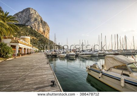 Calpe Alicante marina boats with Penon de Ifach mountain in Mediterranean sea in Spain - stock photo
