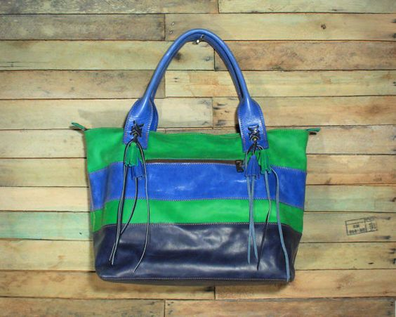 This Blue and Green Bag, is the perfect summer handbag! It is medium size and made in genuine leather. I love this bag because it combines so many features (bright colors, tassels, leather embroidery and bronze color hardware) while still maintaining an overall clean design.  Inner: fabric lining*, inside pocket w/zipper + leather strap to use as key holder. Outer: genuine leather. 1 pocket w/zipper. Zipper across the top.  * Fabric lining may vary.  I also have it in Orange and Aqua! See…