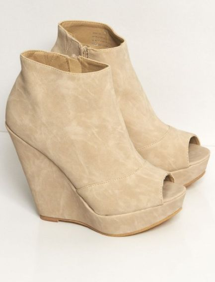 Suede nude wedges.