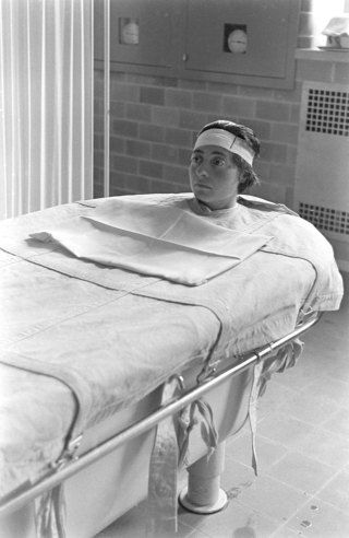 Pilgrim State Hospital, Brentwood, NY, 1938. A mental patient strapped into a continuous-flow tub. This method was used to calm down the patient.  Their bodies were greased, which enabled them to remain in the tub for hours and gradually fall asleep.