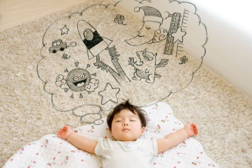 Stock-Foto : Baby boy (12-17 months) sleeping and having a dream, digital composite