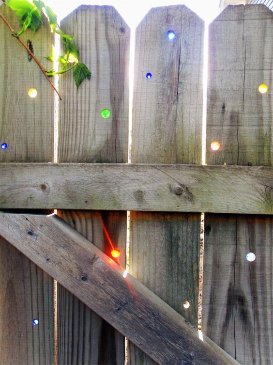 If I had a fence I would put marbles in the holes like this. So cool!