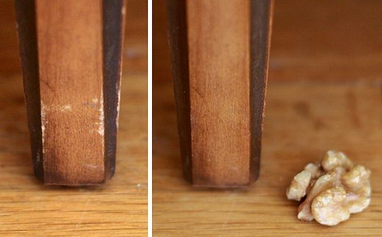 This sounds amazing, so I must try:  1. Identify areas of your wooden furniture that are unsightly because they have been bumped or scraped. 2. Get your walnut. 3. Rub the walnut on the damaged area.  4. Watch in amazement as the damaged area begins to darken.