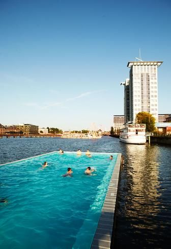 The Badeschiff, a floating swimming pool in Berlin. It opened in the summer of 2004 as an art project organized by the Stadtkunstprojekte (City Art Project Society) of Berlin. It was created by local artist, Susanne Lorenz, to enliven city life along a long-neglected stretch of the Spree.