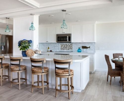 beach kitchen with light blue tiles, blue glass pendants and nautical