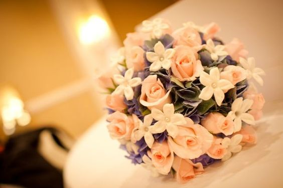 bouquet with blue, white, and pink