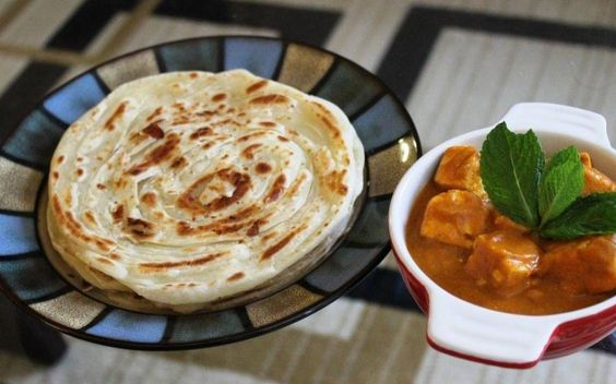 Malabari Parotta or Kerala Parotta is a layered flatbread made from refined flour (maida). This is a traditional recipe from Kerala.