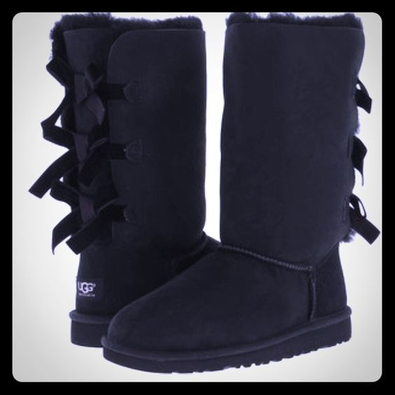 UGG Australia Tall Bailey Bow Boots. Authentic Black Bailey Tall Bow Boots.  Slip on with 7 1/2 inch shaft.  These are super comfortable. This is my first time buying these boots I just wasn't as in love with it as I thought I would be.  Feel free to ask questions. UGG Shoes Ankle Boots & Booties