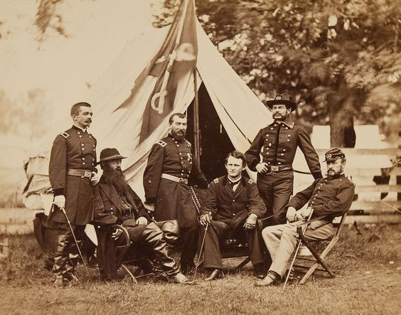 Maj. Gen. Philip Sheridan and his generals in front of Sheridan's tent, 1864. Left to right: Henry E. Davies, David McM. Gregg, Sheridan, Wesley Merritt, Alfred Torbert, and James H. Wilson.
