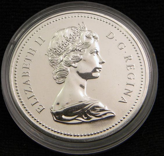 1976 Canada Dollar Parliament Library Centennial Coin by OlyTrader