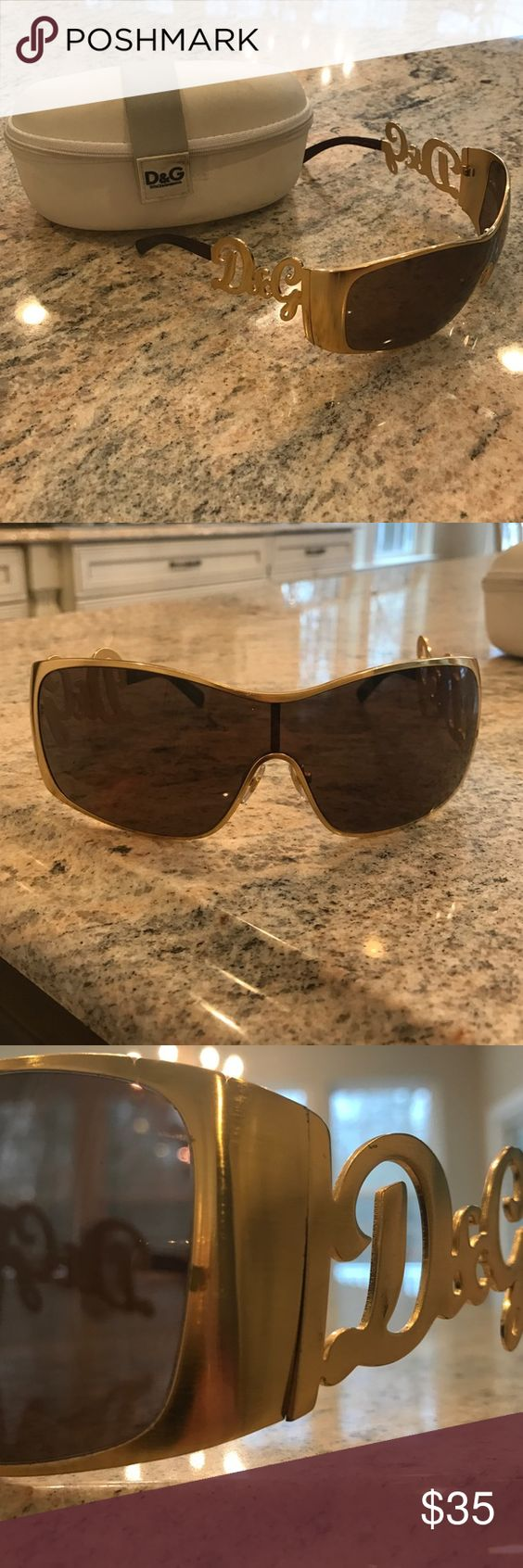 D&G sunglasses Gold colored unisex D&G sunglasses. Has a small mark on right gold rim(shown in picture) and minor scratches on lenses(normal used condition) they are also a little wide on the head and would fit a man or could be adjusted a little Dolce & Gabbana Accessories Glasses