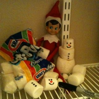 Cute Elf on the Shelf idea~ in the pantry building marshmallow snowmen...except possibly don't use Sharpies, as the kids are going to want to eat the marshmallows after discovering the elf!  Need food markers or icing...