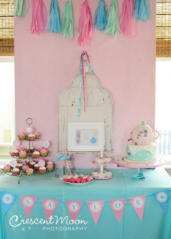 A pretty pink and light teal are the perfect combo! Bird cage adds a little vintage flare!