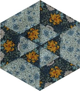 Barbara Brackman's MATERIAL CULTURE, Becky Brown used the light blue Carnation print in Block #10.