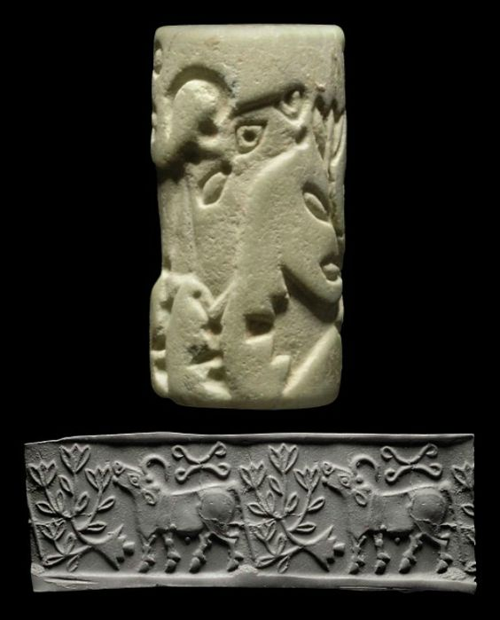 AN ELAMITE GREEN STONE CYLINDER SEAL   CIRCA 3000 B.C.   With the figure of a striding bull, head raised, with large curling horns and dotted eyes, a stylized flowering tree in front, two conjoined scrolling lines in the field  1 in. (2.5 cm.) high