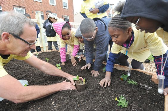 In the 500 block of Laurens St., Bill Dawson, far left, shows second graders from New Song Academy how to plant vegetables and flowers. More than 32 vacant city lots will be transformed into a community garden as part of The Scotts Miracle-Gro Company and The U.S. Conference of Mayors nationwide GRO1000 gardens and green spaces program.: Plant Vegetables, Song Academy, L'Wren Scott, Gro1000 Gardens, Scotts Miracle, City Gardens