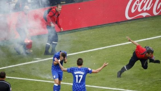Crowd trouble and flares on the pitch marred the Euro 2016 Group D draw between Croatia and the Czech Republic.  The match was halted in the 86th minute when flares from the Croatia end rained down on the Saint-Etienne pitch.  A steward appeared to be hurt by a firework during a five-minute stoppage.
