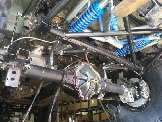 Jeep JKU Rubicon Frog 1 Build at Clayton Off Road Mfg. - Rear shocks and axle installed.