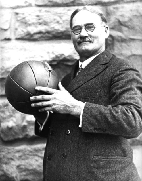 James Naismith invented the game of basketball in 1891. Thirteen basic rules guided the play, which featured two peach baskets as the goals. Naismith moved to Lawrence, Kansas, in 1898 to serve as a professor, and the school's first basketball coach, at the University of Kansas.