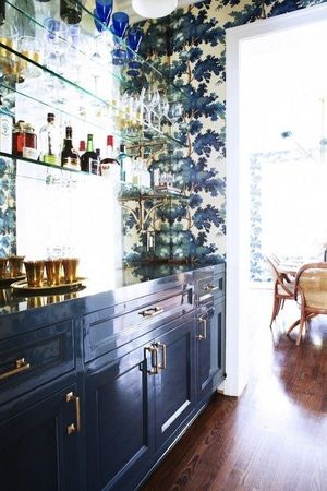 Navy blue cabinets and brass hardware. Gorgeous