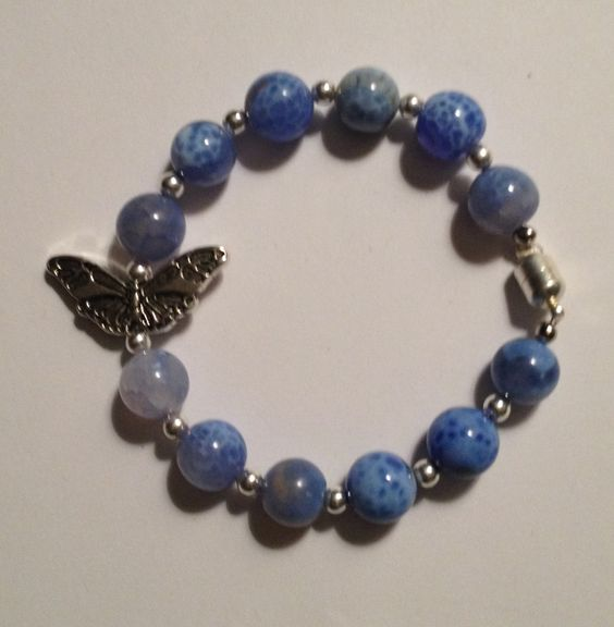 Spring 2013 Collection: 7 1/2 inch bracelet made with light blue stone beads, silver spacer beads and a large silver butterfly bead with a magnetic clasp. $19.99