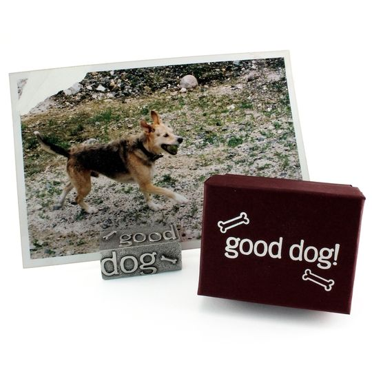 This stand won't fetch your slippers or wag its tail, but it will proudly display your furry best friend.