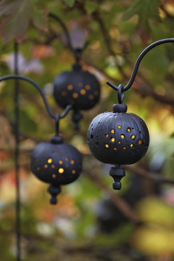 Light up a dark evening with pumpkins designed to resemble lanterns. You can quickly make enough to use as path lights.