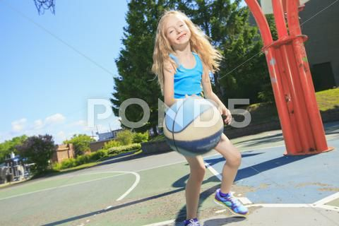 A Little Girl Play Basketball With On The Playground Hi Res 46907208 With Images Girls Play Girl Photos Little Girls