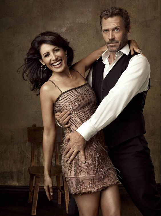 I'm not jealous of the Hugh Laurie part of this photo, but her smile is infectious!