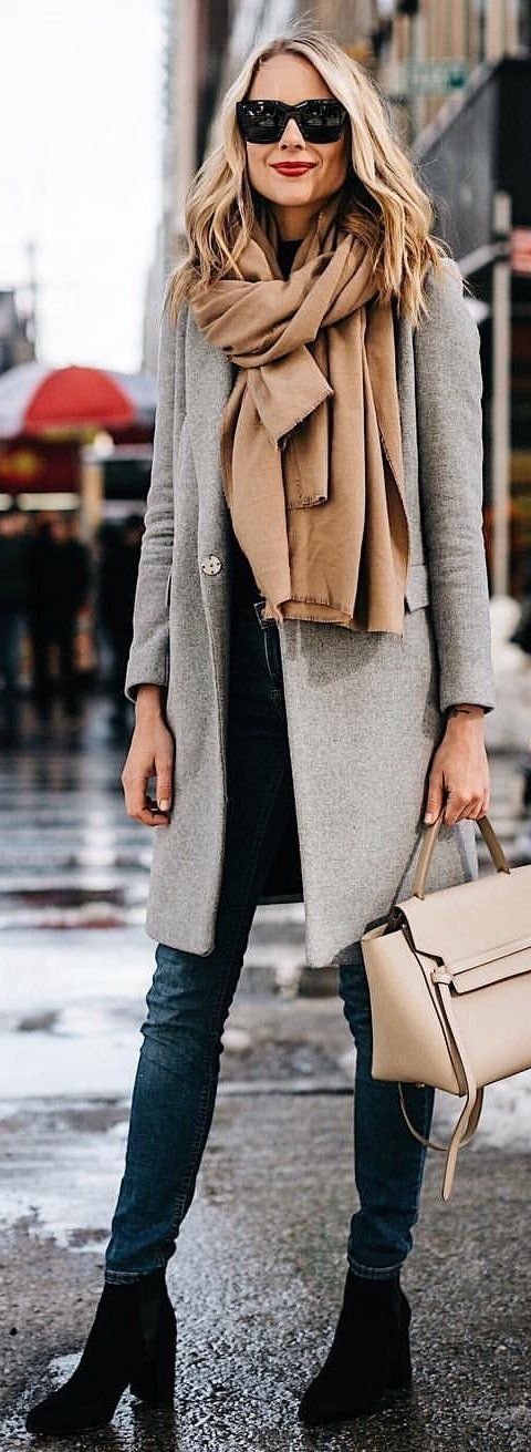 #winter #outfits brown scarf, gray coat, blue skinny jeans, and pair of black booties