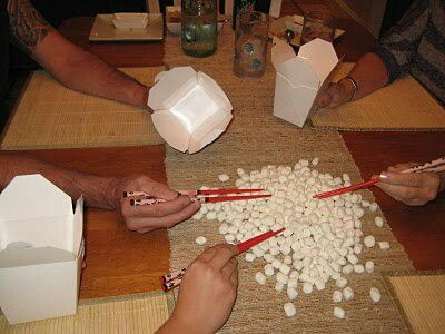 Minute to win it game: putting marshmallows in a cup with chipsticks